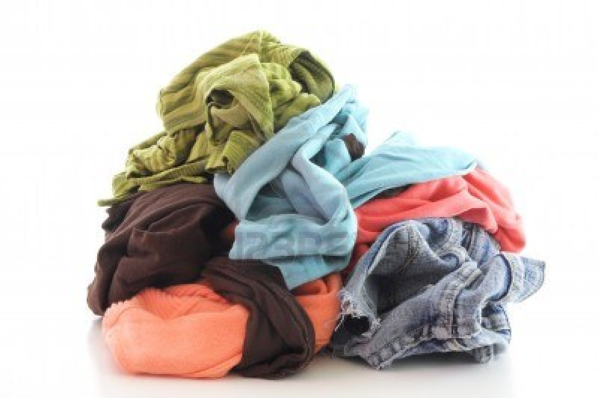 7180126-a-pile-of-dirty-clothing-isolated-on-white-background